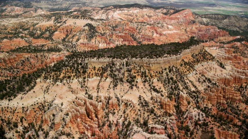 Flying by a mesa, hoodoos and buttes, Bryce Canyon National Park, Utah Aerial Stock Footage | AX130_441