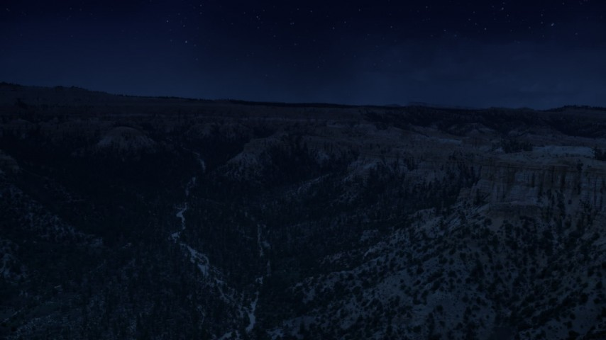 4K day for night color corrected aerial footage flyby wide canyon with trees, surrounded by hoodoos, buttes, Bryce Canyon National Park, Utah Aerial Stock Footage | AX130_454_DFN