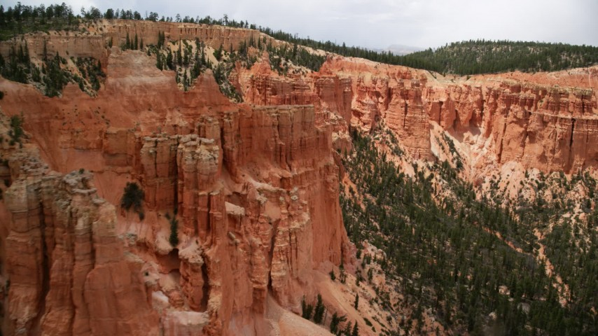 6K stock footage aerial video of passing by hoodoos overlooking box canyon between mesas, Bryce Canyon National Park, Utah Aerial Stock Footage | AX130_468