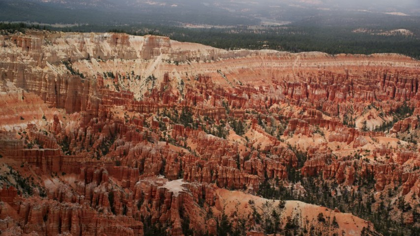 Flying by groups of hoodoos, buttes, Bryce Canyon National Park, Utah Aerial Stock Footage | AX130_475