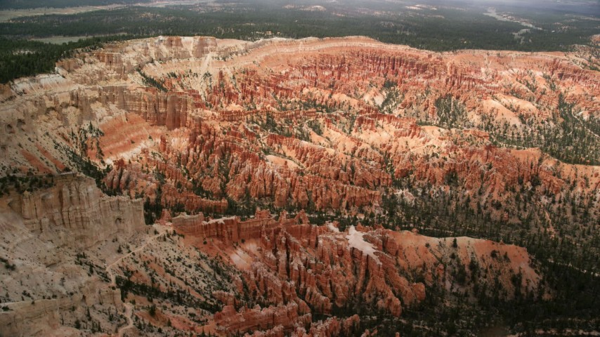 Flying by groups of hoodoos and buttes, Bryce Canyon National Park, Utah Aerial Stock Footage | AX130_477