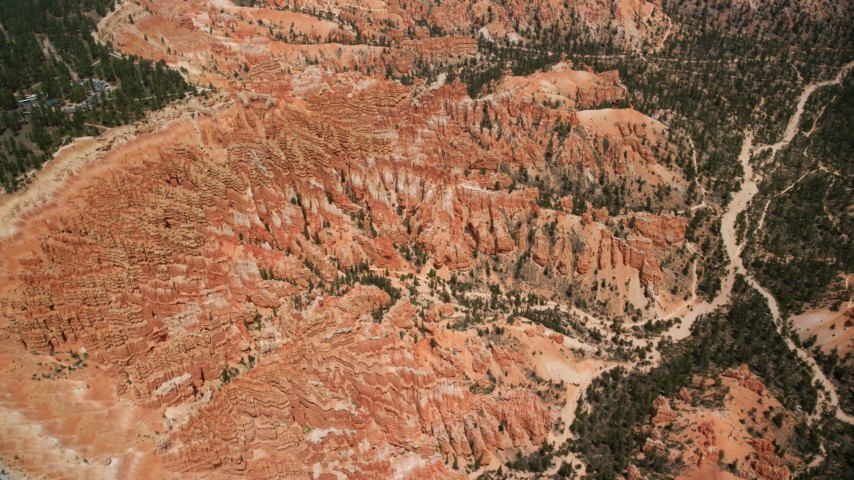 6K stock footage aerial video of circling around groups of hoodoos and buttes on a cliffside, Bryce Canyon National Park, Utah Aerial Stock Footage | AX130_482