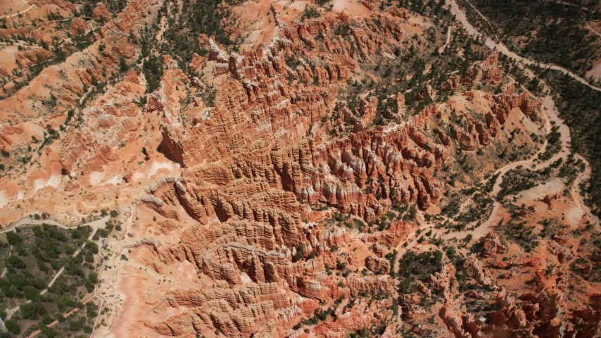 Bird's eye view orbiting groups of hoodoos and buttes, Bryce Canyon National Park, Utah Aerial Stock Footage | AX130_483