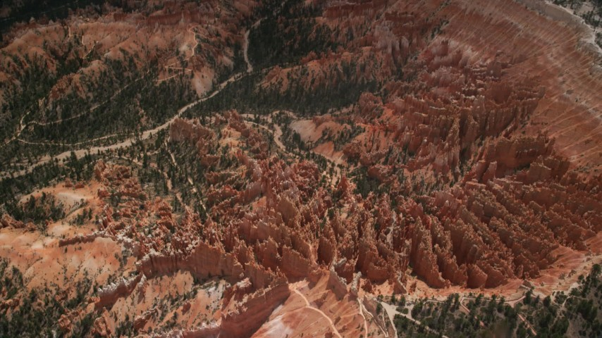 Tilt up, flying away from groups of hoodoos and buttes, Bryce Canyon National Park, Utah Aerial Stock Footage | AX130_484