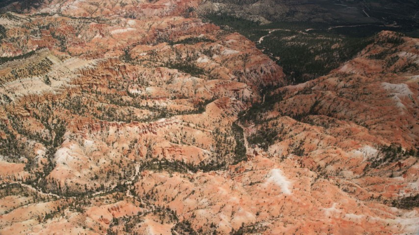 Flying over hills, near hoodoos, Bryce Canyon National Park, Utah Aerial Stock Footage | AX130_485