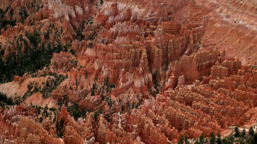 Flying by buttes and hoodoos on a cliffside, Bryce Canyon National Park, Utah Aerial Stock Footage | AX130_488