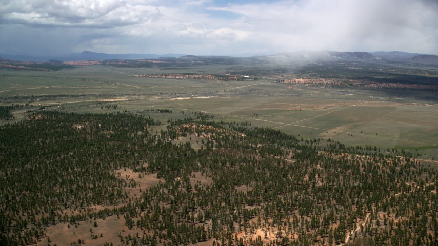 Flying by forest and valleys outside the national park, Bryce Canyon National Park, Utah Aerial Stock Footage | AX130_492