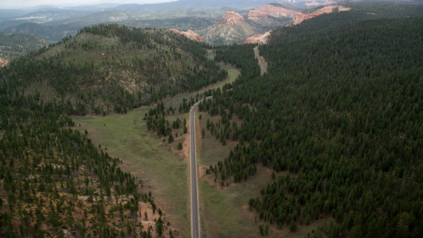 Flying over Highway 63, forest, approaching Bryce Canyon National Park, Utah Aerial Stock Footage | AX131_009