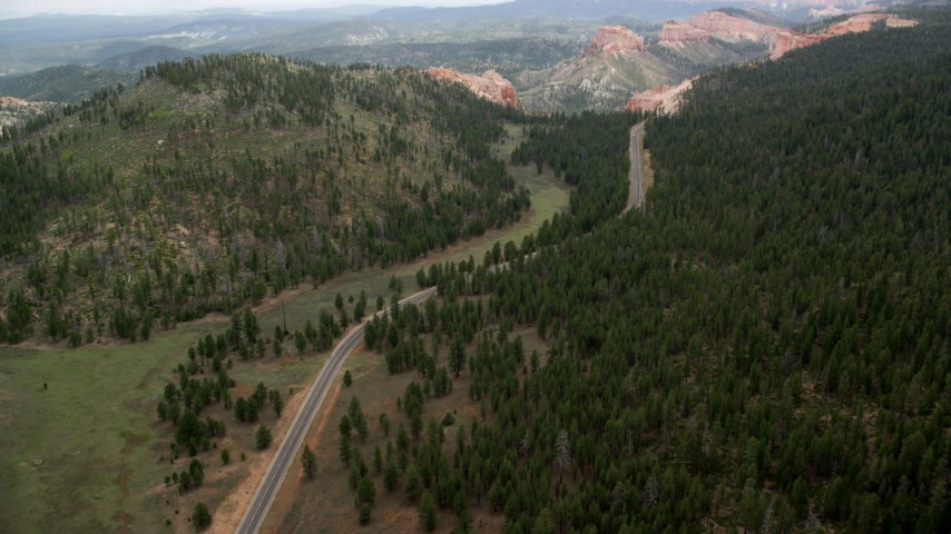 6K stock footage aerial video of Highway 63, forest, approach Bryce Canyon National Park, Utah Aerial Stock Footage | AX131_010