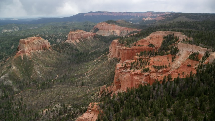 Approach cliff near Swamp/Mud Canyon Buttes, Bryce Canyon National Park, Utah Aerial Stock Footage | AX131_013