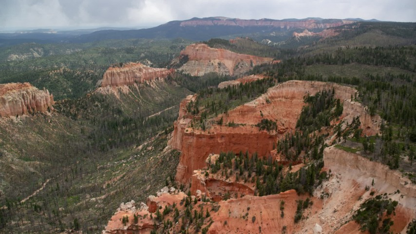 Flying over cliffs near Mud Canyon Butte, Bryce Canyon National Park, Utah Aerial Stock Footage   AX131_014