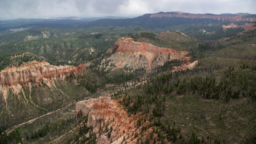 Flying by Mud Canyon Butte, Bryce Canyon National Park, Utah Aerial Stock Footage | AX131_015