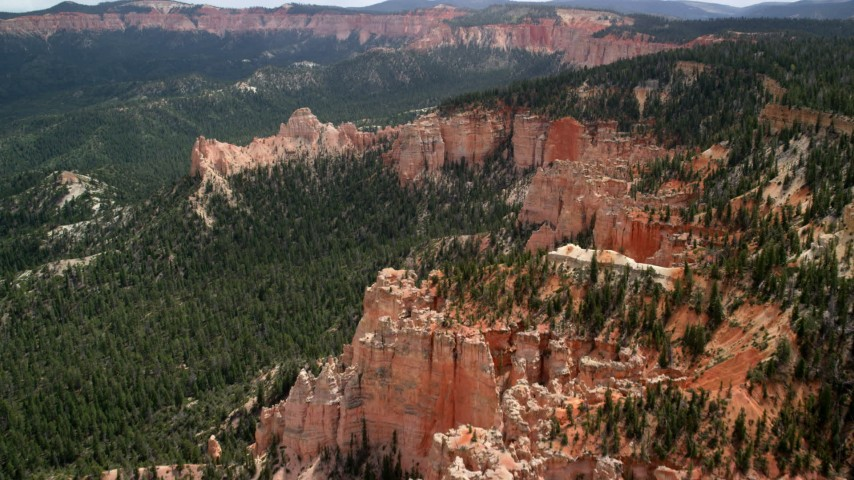 Flying over and approaching buttes, forest, Bryce Canyon National Park, Utah Aerial Stock Footage | AX131_018