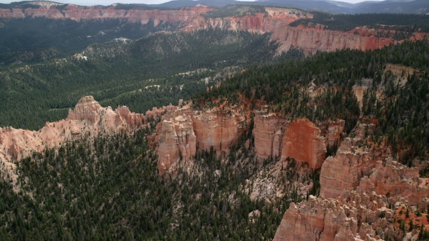 Approaching and flying over buttes, forest, Bryce Canyon National Park, Utah Aerial Stock Footage | AX131_019