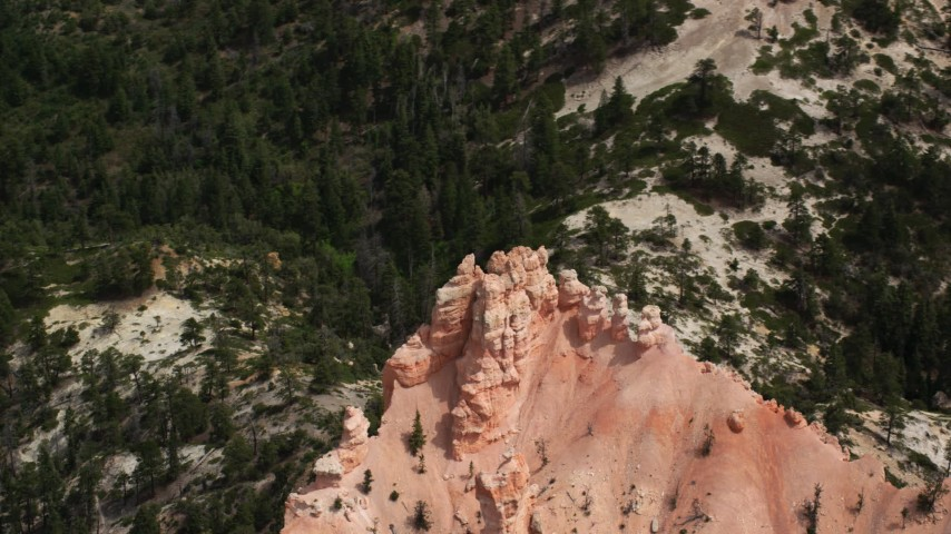 6K stock footage aerial video of orbiting a butte, hoodoos, surrounded by trees, Bryce Canyon National Park, Utah Aerial Stock Footage | AX131_020