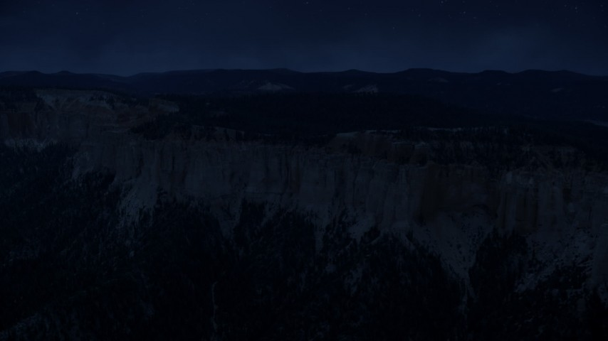 4K day for night color corrected aerial footage of flying by rock formations, Pink Cliffs, trees, Bryce Canyon National Park, Utah Aerial Stock Footage | AX131_021_DFN