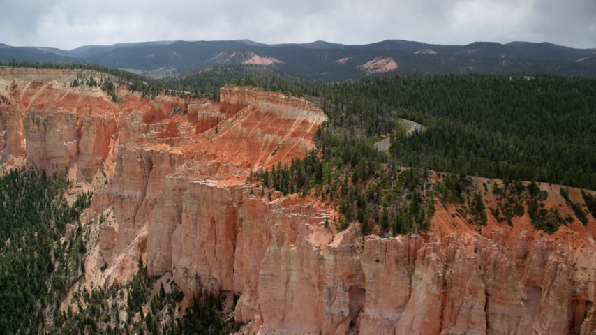 6K stock footage aerial video flyby and pan across rock formations, Pink Cliffs, Bryce Canyon National Park, Utah Aerial Stock Footage | AX131_023