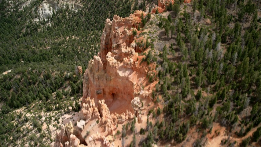 6K stock footage aerial video of a bird's eye view of Pink Cliffs, trees, Bryce Canyon National Park, Utah Aerial Stock Footage | AX131_025