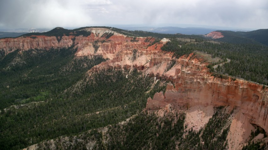 Approach and fly by rock formations, Pink Cliffs, Bryce Canyon National Park, Utah Aerial Stock Footage | AX131_026