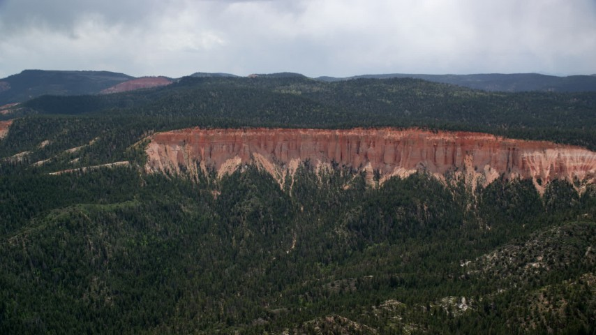 Flying away from rock formations, Pink Cliffs, Bryce Canyon National Park, Utah Aerial Stock Footage | AX131_035