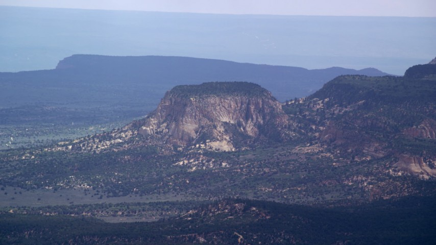 Flying by large butte, Grand Staircase-Escalante National Monument, Utah Aerial Stock Footage | AX131_038