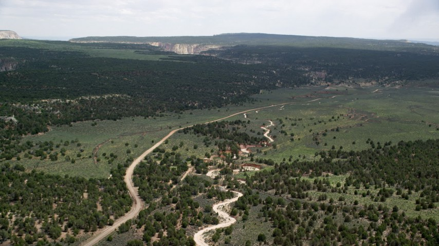 6K stock footage aerial video of a dirt road near forest, Grand Staircase-Escalante National Monument, Utah Aerial Stock Footage | AX131_040
