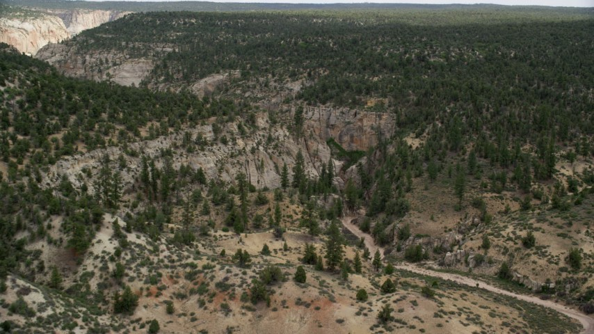 Approaching rocky canyon, Grand Staircase-Escalante National Monument, Utah Aerial Stock Footage | AX131_044