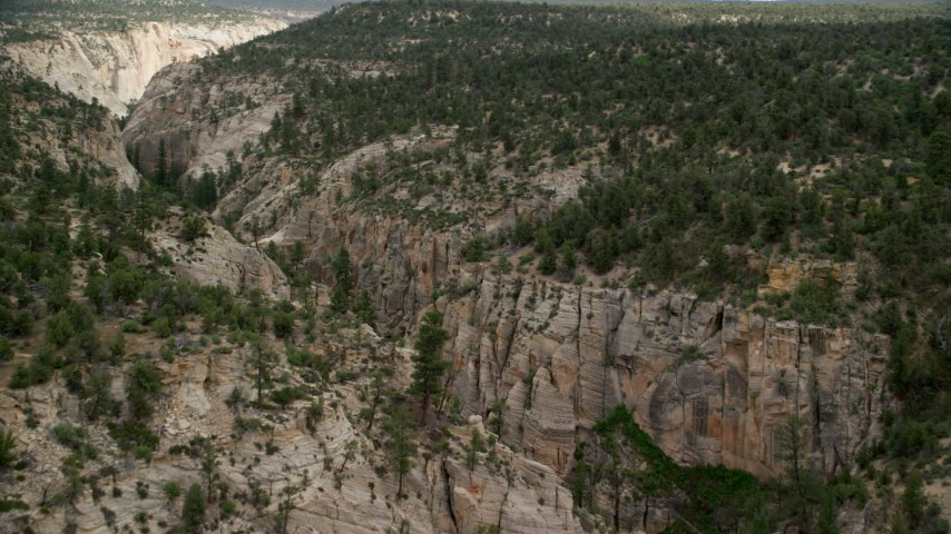 Flying over narrow canyon, Grand Staircase-Escalante National Monument, Utah Aerial Stock Footage | AX131_045