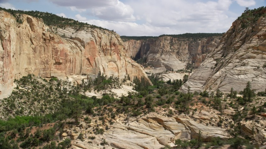 6K stock footage aerial video of flying low through a canyon, Grand Staircase-Escalante National Monument, Utah Aerial Stock Footage | AX131_049