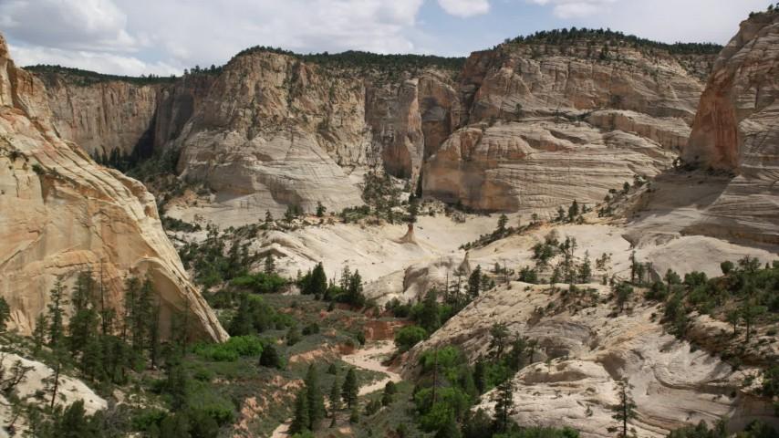 Flying through narrow canyon, Grand Staircase-Escalante National Monument, Utah Aerial Stock Footage | AX131_051