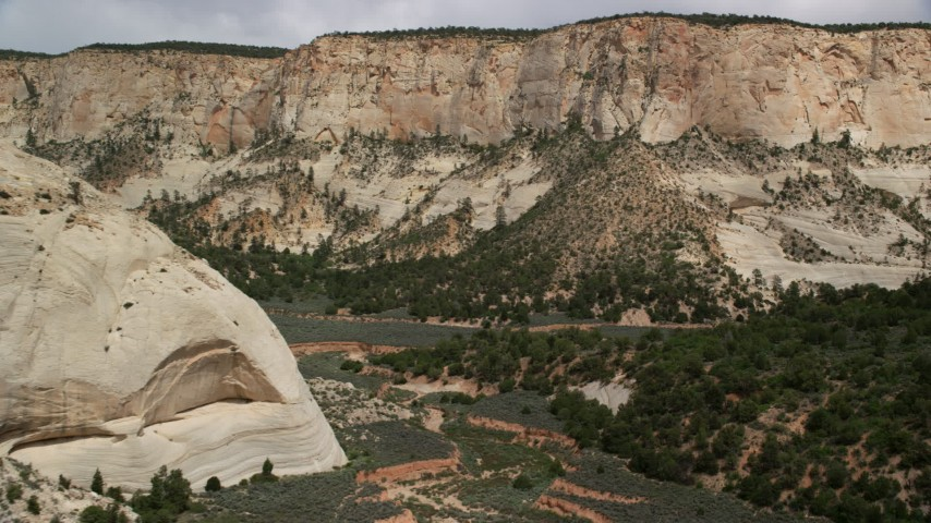 Flying low through canyon, Grand Staircase-Escalante National Monument, Utah Aerial Stock Footage | AX131_055