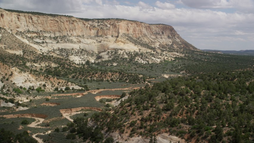 6K stock footage aerial video of flying low through canyon, Grand Staircase-Escalante National Monument, Utah Aerial Stock Footage | AX131_056