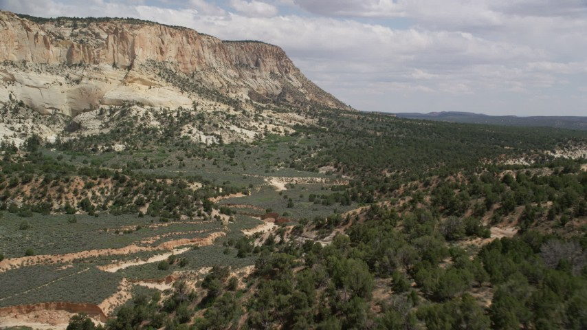 Flying over dry riverbed, Grand Staircase-Escalante National Monument, Utah Aerial Stock Footage | AX131_057