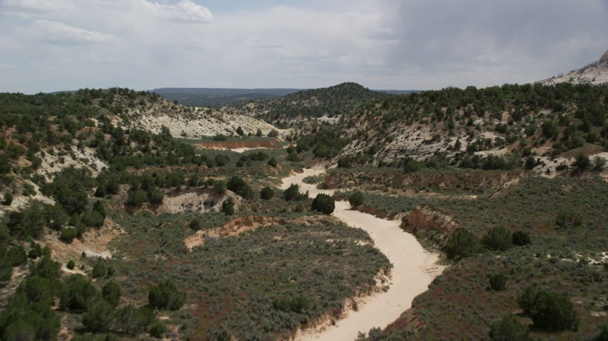 6K stock footage aerial video of flying low over dry riverbed, Grand Staircase-Escalante National Monument, Utah Aerial Stock Footage | AX131_058