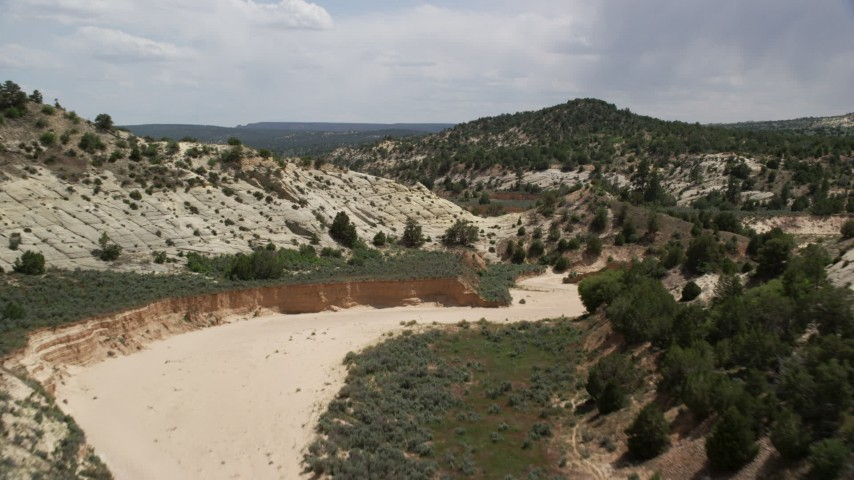 6K stock footage aerial video of flying low over dry riverbed, Grand Staircase-Escalante National Monument, Utah Aerial Stock Footage AX131_059 | Axiom Images