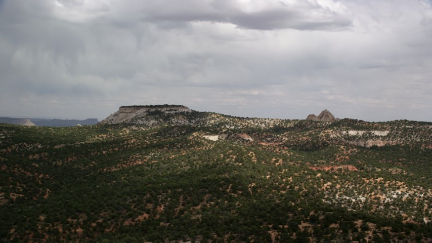 Flying by small mesa, hills, Grand Staircase-Escalante National Monument, Utah Aerial Stock Footage | AX131_071