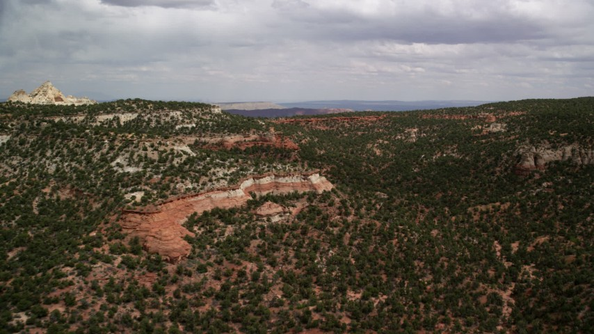 Flying over hills, near mesas, Grand Staircase-Escalante National Monument, Utah Aerial Stock Footage | AX131_072