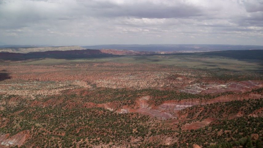 6K stock footage aerial video of approaching hills, wide valley, Glen Canyon National Recreation Area, Utah, Arizona Aerial Stock Footage | AX131_073
