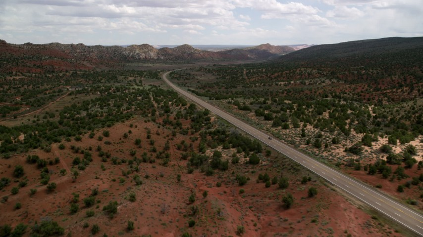 6K stock footage aerial video of approaching SUV on Highway 89 through Glen Canyon National Recreation Area, Utah, Arizona Aerial Stock Footage | AX131_080