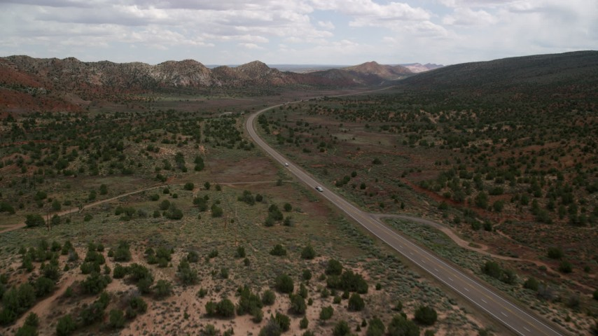 6K stock footage aerial video of following Highway 89 through Glen Canyon National Recreation Area, Utah, Arizona Aerial Stock Footage | AX131_081
