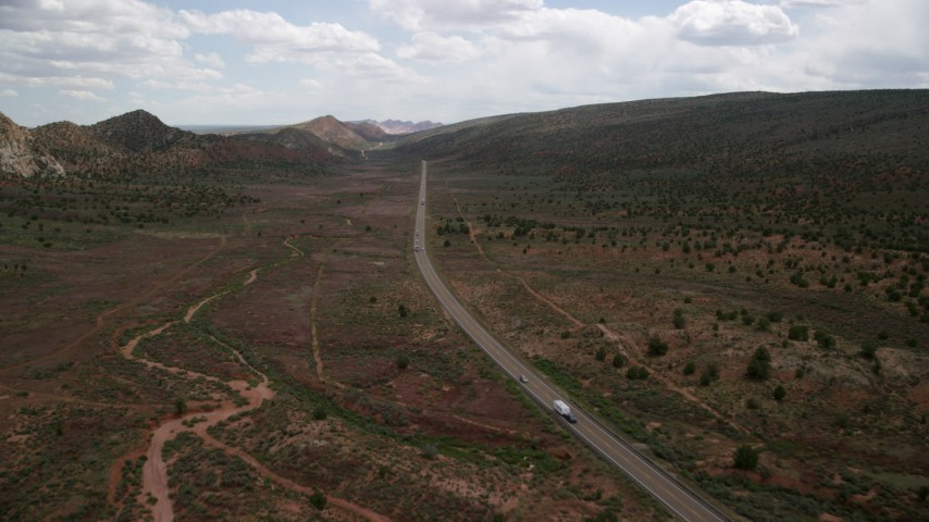 Following Highway 89, Glen Canyon National Recreation Area, Utah, Arizona Aerial Stock Footage | AX131_083