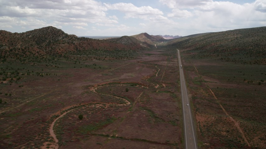 6K stock footage aerial video of flying past Highway 89 through Glen Canyon National Recreation Area, Utah, Arizona Aerial Stock Footage | AX131_085