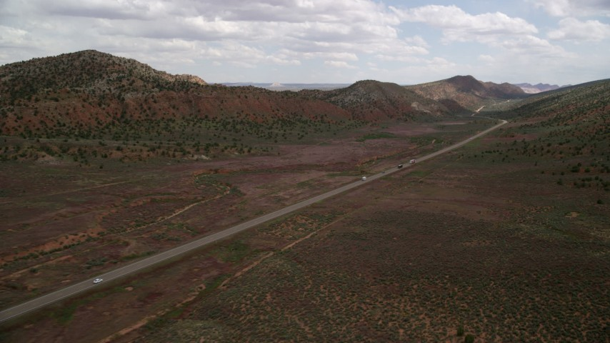 6K stock footage aerial video of flying by light traffic on Highway 89, Glen Canyon National Recreation Area, Utah, Arizona Aerial Stock Footage | AX131_086