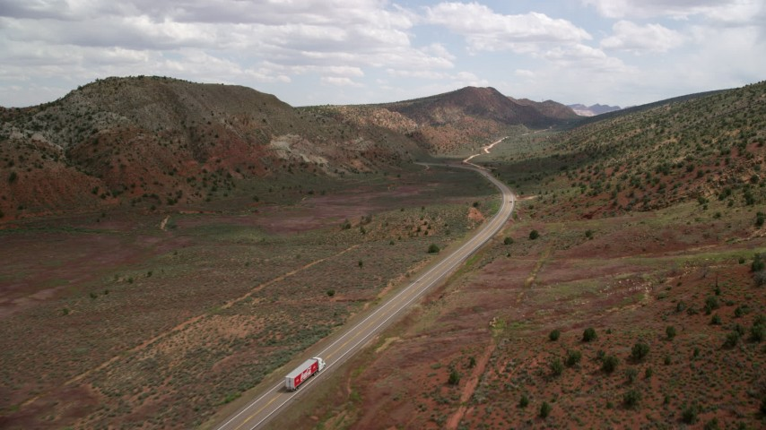 6K stock footage aerial video flyby truck and buss on Highway 89, Glen Canyon National Recreation Area, Utah, Arizona Aerial Stock Footage | AX131_088