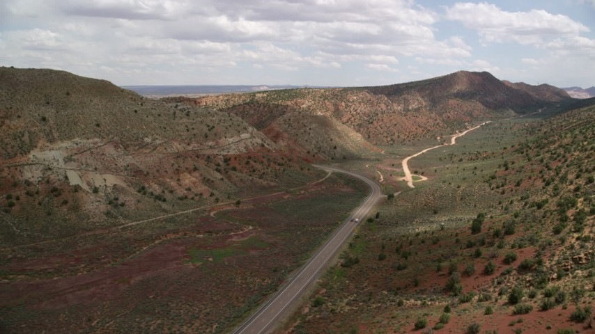 Tracking car, Highway 89, Glen Canyon National Recreation Area, Utah, Arizona Aerial Stock Footage | AX131_089