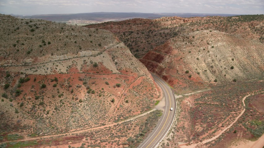 6K stock footage aerial video track a car on Highway 89, Glen Canyon National Recreation Area, Utah, Arizona Aerial Stock Footage | AX131_090