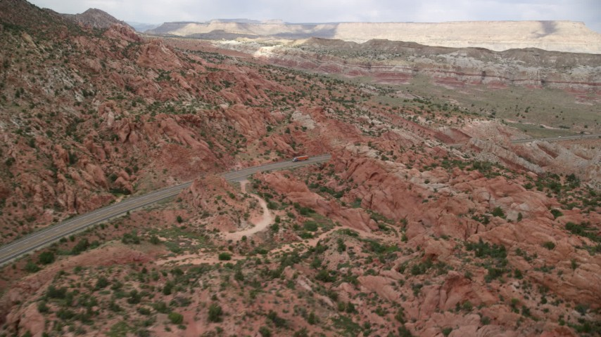 6K stock footage aerial video pan across Highway 89, Glen Canyon National Recreation Area, Utah, Arizona Aerial Stock Footage | AX131_092