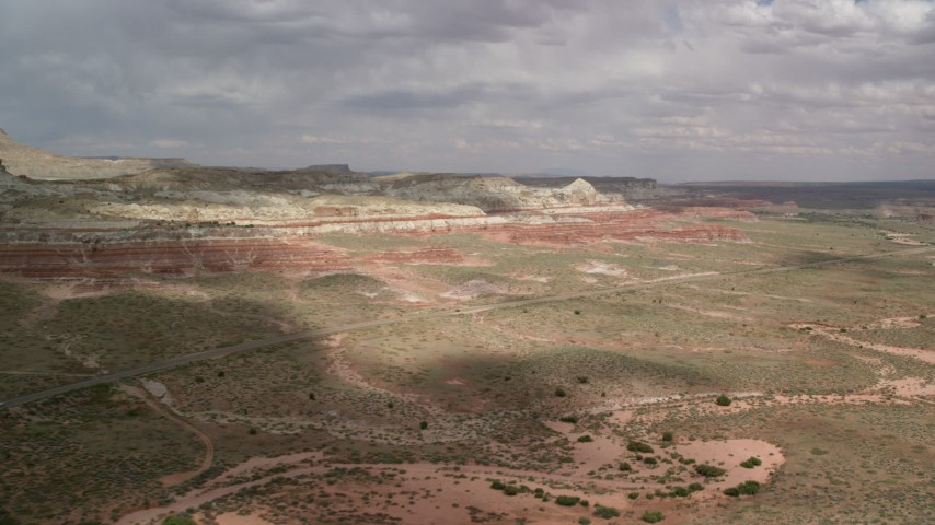 6K stock footage aerial video approach and pan across Highway 89, Glen Canyon National Recreation Area, Utah, Arizona Aerial Stock Footage | AX131_093