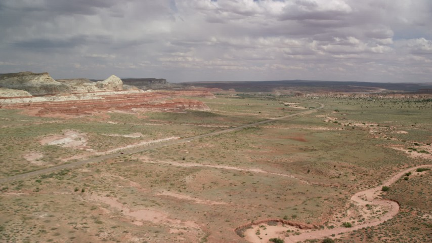 6K stock footage aerial video descend and approach Highway 89, Glen Canyon National Recreation Area, Utah, Arizona Aerial Stock Footage | AX131_094