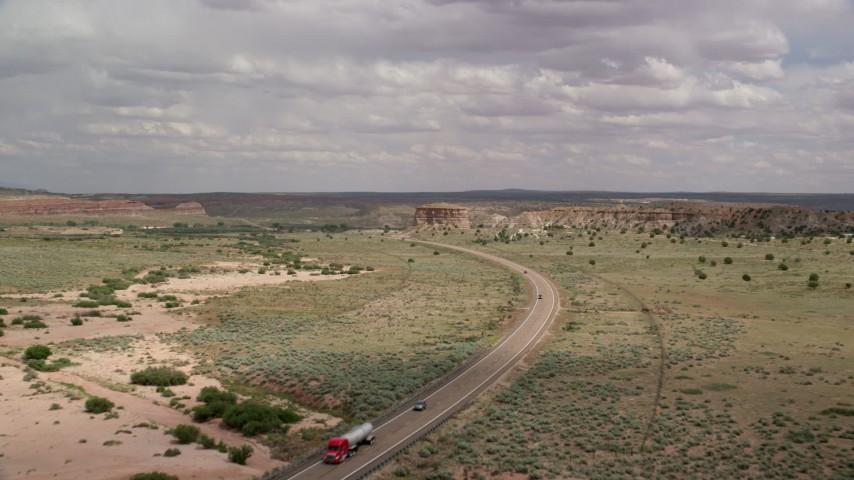6K stock footage aerial video fly toward and follow Highway 89, Glen Canyon National Recreation Area, Utah, Arizona Aerial Stock Footage | AX131_096